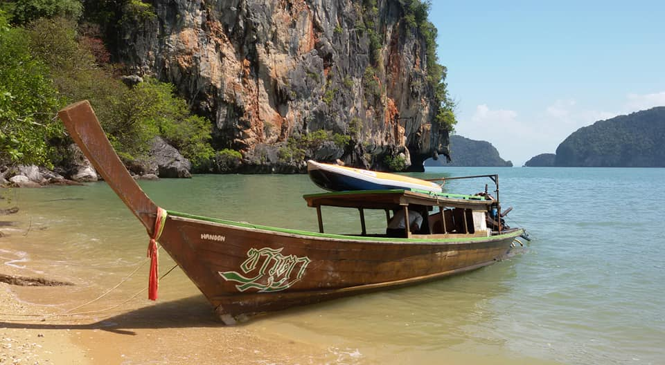 Longtail and kayak in Phang Nga bay